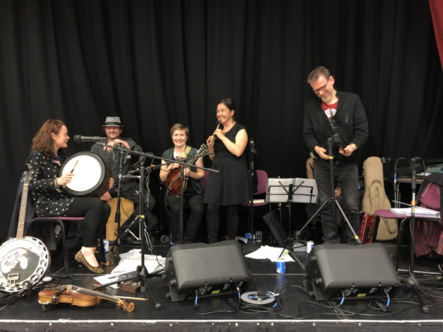 Image of Jess on stage with Brighton Ceilidh
